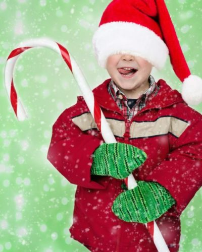 christmas boy holding candy cane
